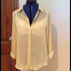 Polyester light weight top This soft yellow and taupe button up top is NWOT. Never worn. Long sleeves can be rolled up and buttoned at about elbow length. Darted front for more flattering fit.  Great top IN Studio Tops
