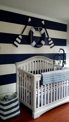 Blue and White Striped Accent Wall in a Nautical Nursery - so preppy!