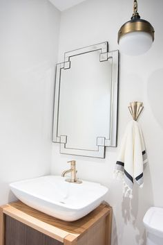 Guest bathroom, pendant light, single sink vanity, brass accents