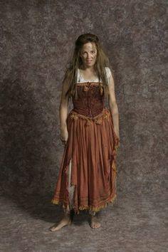 Costume Rental  Aldonza  cream distressed skirt & sleeveless blouse w/distressed rust overskirt & corset  Size M  Gender  Fee  $$30.00