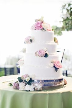 Four-Tiered White Wedding Cake with Pink Flowers | Sweetcakes | Angie Silvy Photography | TheKnot.com