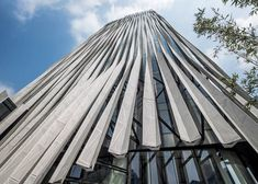 Strips of perforated aluminium give a pleated appearance to the facade of this Shanghai tower designed by Kengo Kuma for the property developer Soho China. Building Skin, Building Facade, Building Design, Kengo Kuma, Japanese Architecture, Facade Architecture, Classical Architecture, Shanghai Tower, Aluminium Cladding