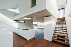 Architectures Architecture Interior White Kitchen Island Wooden Floor And Stair Grip Ceiling Lamp Transparent Glass Wall Empty Room Inspiring Long Tall and Narrow Plak Residence by Propeller Z Wooden Floor Lamps, Wooden Flooring, White Floor Lamp, White Kitchen Island, Beach House Kitchens, White Building, Empty Room, Architect House, Story House