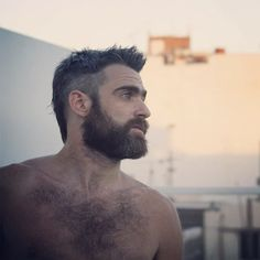 Beard;)...and excuse me...but I still love a man w/ some hair on his chest!