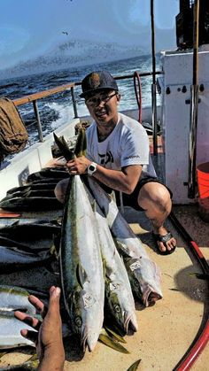 Team Member Andrew Le with a handful of Yellowtail Tuna.
