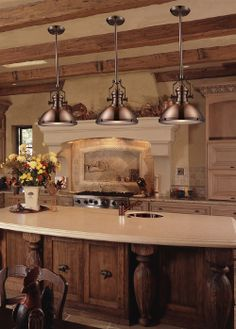 Love the Industrial lighting over island and the marble counter top ;)