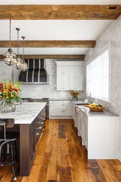 Great kitchen - wide plank floor, globe pendants, full height herringbone marble tile backsplash - Astro Design Center