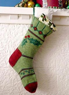 This festive stocking pattern cleverly uses both stranded colourwork and duplicate stitch to create cheerful holly motifs. Knit in a DK weight yarn, it is worked just like an oversized sock and is lined with felt for added sturdiness. Knitted Christmas Stocking Patterns, Knitted Christmas Stockings, Knit Stockings, Christmas Patterns, Christmas Gifts For Women, Christmas Crafts, Holly Christmas, Christmas Ornaments, Crochet Christmas