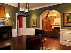 Green Dining Room - also, interesting that the archway is painted to match…