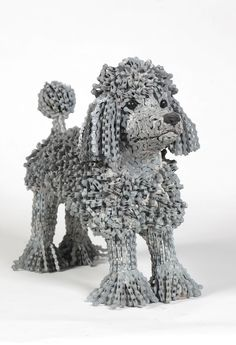 This artist creates dog sculptures from recycled bicycle chains Check more at http://giveitlove.com/artist-creates-dog-sculptures-recycled-bicycle-chains/