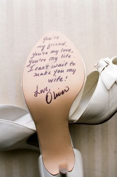 Groom writes on his brides shoes before she walks down the aisle.- this might just be the cutest thing ive ever seen!  www.dieselpowergear.com #bride #brides #groom #flowergirl #weddings #weddingideas #weddingdresses #bridesmaids #flowers #outdoorwedding #barnwedding #churchwedding #weddinghair #weddingcakes #weddingrings #weddingdecorations  #countrywedding
