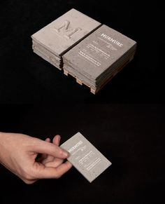 Concrete Business Cards - Concrete business cards … yes concrete! Playing with the notion of scales, Murmure created a set of business cards made of concrete. This material, so characteristic of our environment, was enhanced by using the smallest and most refined communication support. The refinement and the technique required for the typography highlight the harshness and the roughness of the used material.