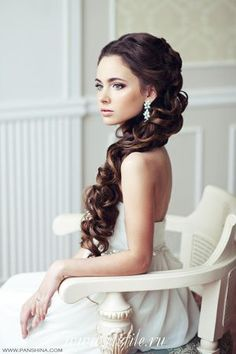 Wedding hairstyle Long curls pulled to one side