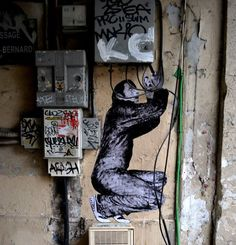 Fun Site-Specific Wheatpastes on the Streets of France by Levalet