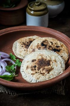 Bajra Gobi Matar Paratha, a healthy Indian style Flat bread recipe which is stuffed with cauliflower and green peas masala.