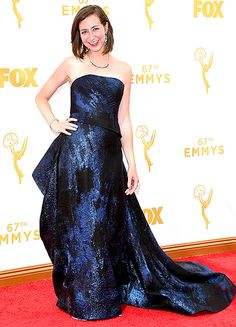 Kristen Schaal in a sapphire-hued Rubin Singer dress with a ruffled back and a long train at the 2015 Emmy Awards.  Read more: http://www.usmagazine.com/celebrity-style/pictures/emmy-awards-2015-red-carpet-fashion-2015189/47252#ixzz3maJDrdaj  Follow us: @usweekly on Twitter | usweekly on Facebook