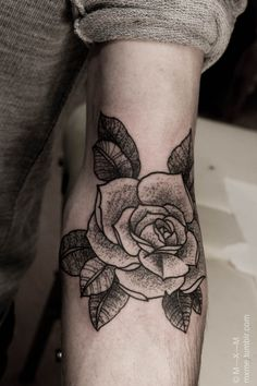 My dad had two tats.  A rose like this one on his forearm with my name over it and a silhouette of my mother on his bicep with her name.  We are his girls!