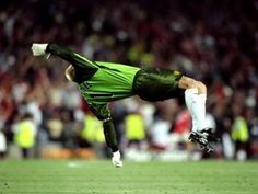 Following Ole Gunnar Solskjaer's winner, Schmeichel was pictured cartwheeling inside his own penalty area in celebration of the Red Devils' win, which earned them an historic treble. The image that is now affectionately associated with the keeper also marked his final moments as a Manchester United player. Manchester United Players, Football Photos, The Unit, In This Moment, World, Soccer Teams, Celebrities, 15 Years, Pictures