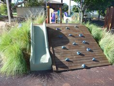 smaller version for bottom of slope near fence/driveway? - The climbing wall and slide at Pied Piper preschool