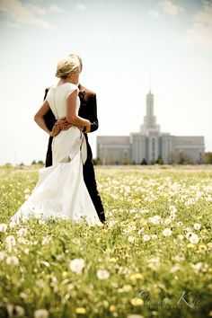 Picture of Lindsey and Brandon in front of their church!!!!!!  in the background, yes !!!!