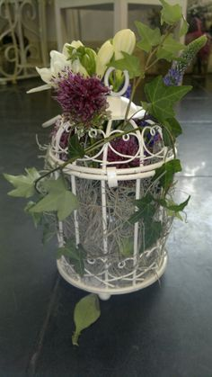 Bird cage floral arrangement with allium,freesia,tuberose,hedera,blue veronica and tillandsia moss designed by Adrian Ionita