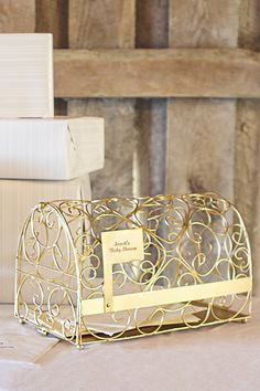 An elegant alternative to the usual gift card boxes. This gold wire gift card mailbox holder is a cute idea for a baby shower, birthday party, or graduation party. Features a working mailbox flag laser engraved with custom personalization.  After the party, use as a planter box, mail holder, or decoration.  To order, visit http://www.tippytoad.com/gold-mailbox-gift-card-holder.asp