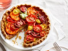 Heirloom Tomato Pie : With a cheesy cornmeal crust and an onion-laced filling, this light, savory pie lets in-season tomatoes shine.