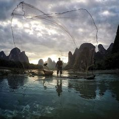 'It's fascinating to see the cormorant fishermen work. Here he casts his net at sunset!' - @king_roberto, #lpInstaTakeover. #travel #China.