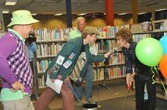 """caddy """"stacks,"""" local """"Masters"""" - mini golf in the library.  This was an adult event in Lawrence KS, complete with local golf celebrities and a """"19th hole."""""""