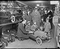 Children and adults check out the latest in toy cars, ca. 1929. DN-0090142. #chicago #history #holidays