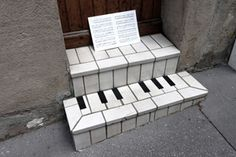 Some of the best street art has humor built into it. In the case of French street artist, OaKoAk, they take what the city gives to them and creates a witty street piece. Who hasn't wanted to turn a tile doorstep into a piano, or a sewer cover into a Viking's shield? More after the jump . . .
