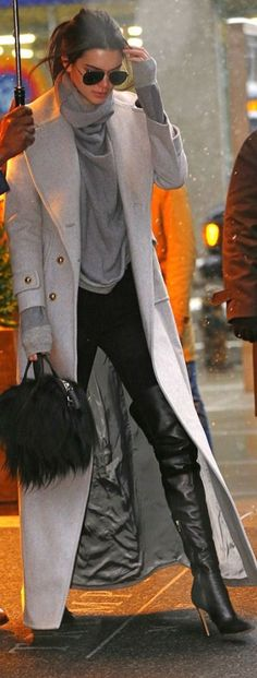 Kendall Jenners gray coat aviator sunglasses black thigh high boots and handbag