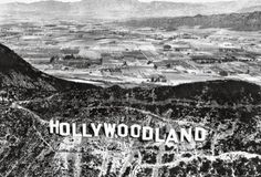 "In 1923 the Hollywood Sign was built by Los Angeles Times publisher Harry Chandler as an epic $21,000 billboard for his upscale Hollywoodland real estate development. Each of the 13 original letters was 30 feet wide and 50 feet tall and the Sign itself featured 4,000 20-watt bulbs, spaced 8 inches apart. At night the Sign blinked into the Hollywood night: first ""Holly"" then ""wood"" and finally ""land,"" punctuated by a giant period."