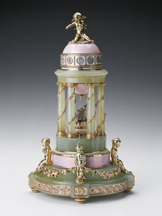 """The Colonnade Egg Henrik Emanuel Wigström for Fabergé, 1910 The Royal Collection """"This Imperial Easter Egg – which incorporates a rotary clock in its design, the movement supplied to Fabergé by Henry Moser & Cie – is in the form of a classical temple Alexandra Feodorovna, Art Nouveau, Rey George, King George, Tsar Nicolas Ii, Fabrege Eggs, Objets Antiques, Faberge Jewelry, Ancient Artifacts"""