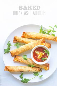Easy Baked Breakfast Taquitos...I'm going to try these made with corn tortillas instead of flour.