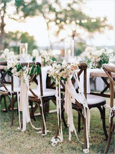 flower and ribbon chair garlands @weddingchicks