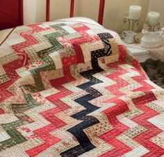 Gather light, medium, and dark charm squares and put them to use in a simple zigzag quilt for the holidays! Find this Christmas Chevron pattern in the book Sew Charming by Country Threads.
