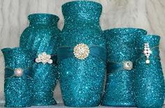 Glitter covered random vases with ribbon and broach...DIY