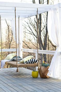 Deck Makeover with Hanging Bench and Privacy Curtains