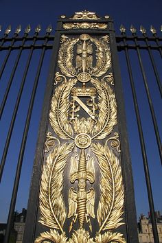 Fence with Napoleon Bonaparte armorial bearings at the castle of Fontainebleau,
