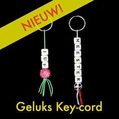 Geluks key-cord of sleutelhanger en/of tassenhanger met gelukspoppetjes.