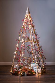 An alternative Christmas tree by The Jubiltree Company, decorated with crabapple branches, found birds' nests, and sweet little birds. | The Jubiltree Company, LLC | Modern Wood Christmas Trees