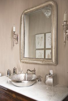 Antique Louis Philippe chest, chandelier,  and silver leaf mirror, custom designed sconce, Match pewter accessories, nickel bronze sink in powder room.