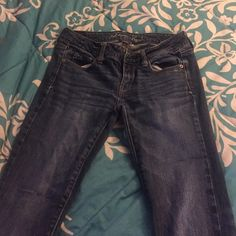 American Eagle Jeans Dark Colored American Eagle Jeans, lightly worn, no discoloration, hole came in pocket, no stretching and no loose strings. American Eagle Outfitters Jeans Straight Leg