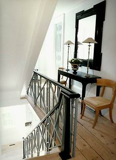 A stair rail idea - I like the combo of wood and metal instead of solid half wall.