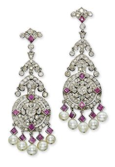 Art Deco pearl, ruby, and diamond earrings by Cartier. Designed in the Indian style. Open work diamond set discs with ruby collets to the cardinal points, suspending a fringe of rubies and pearls. Bijoux Art Deco, Art Deco Earrings, Art Deco Jewelry, Fine Jewelry, Jewelry Design, Pendant Earrings, Pearl Pendant, Pearl Earrings, Pearl Beads