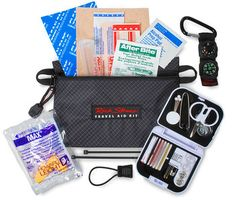 """Travel has its share of unhappy surprises. In one lightweight little pouch, the Rick Steves Travel Aid Kit contains all you need to face a bunch of them: moleskin for blisters, two bandages, antiseptic towelette, insect bite relief, earplugs, pill tube, clear 3"""" x 5"""" repair tape, emergency zipper pull, two zip ties, carabineer compass/thermometer — and a complete sewing kit."""