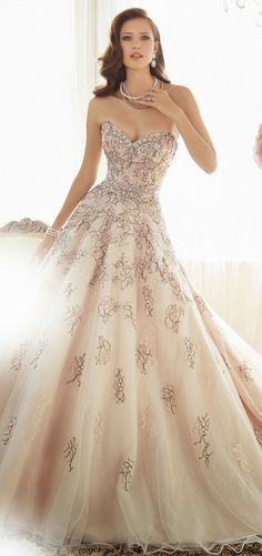 blush wedding gown with black lace applique. #pinkweddingdress http://www.weddingchicks.com/sophia-tolli-2015-bridal-collection/