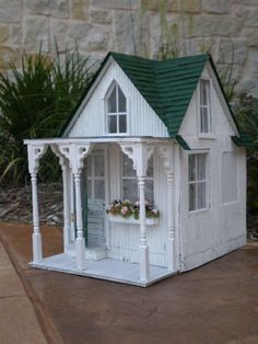 Shabby chic/cottage dollhouse http://myshabbystreamsidestudio.blogspot.com/2010/06/our-new-york-times-interview.html