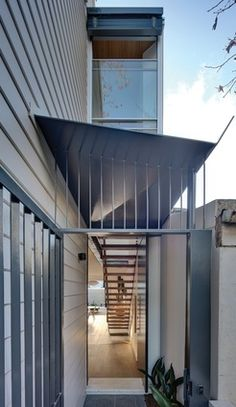 A new front entry was introduced by using the external side passage on the eastern side of the house, protected by a folded steel canopy.